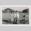 A couple sitting on a bench (ddr-densho-300-14)