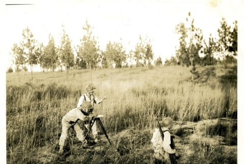Soldiers surveying a field (ddr-densho-22-214)