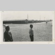 Two boys standing on a camp street (ddr-manz-7-6)