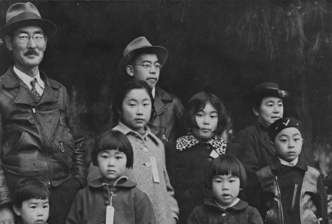 Mochida family ready to board a bus to an assembly center (ddr-csujad-7-6)