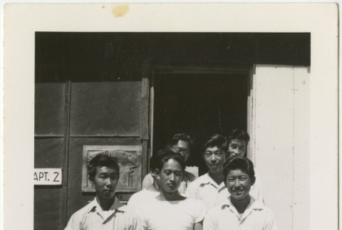 Group of young men in front of barracks (ddr-manz-7-17)