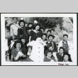 Photograph of a group of people holding snow balls on the side of a mountain with a snowman (ddr-csujad-47-296)