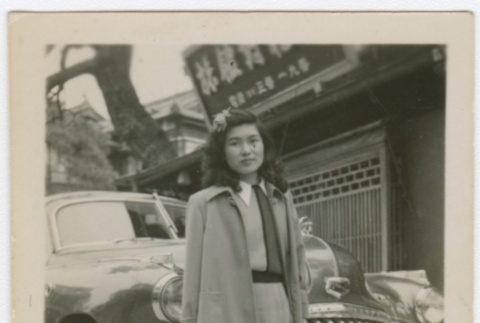 Woman standing in front of car (ddr-densho-332-3)