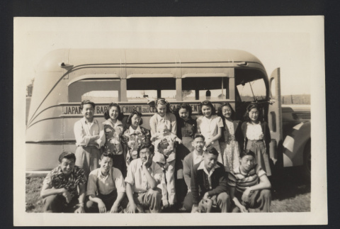 Photograph of Helen Muench with Japanese individuals in front of bus (ddr-csujad-55-2631)
