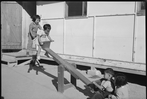 Children playing on a seesaw (ddr-densho-37-603)