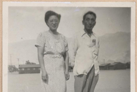Couple standing in front of barracks (ddr-manz-10-69)