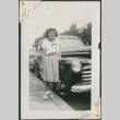 Young woman leaning on a car (ddr-densho-321-214)