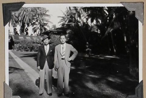 Tokeo Tagami and another man stand on a lawn. (ddr-densho-404-266)