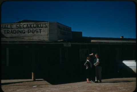 A man and woman in front of Hale Secakuku's Trading Post (ddr-densho-338-498)