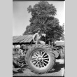 Frank on a tractor (ddr-one-1-574)