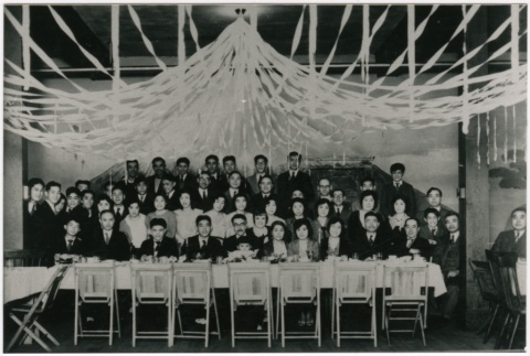 A group gathered behind a table (ddr-densho-353-314)
