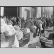 Japanese Americans waiting for the bus (ddr-densho-151-105)