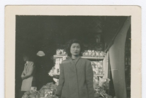 Woman standing in front of fruit stand (ddr-densho-332-2)