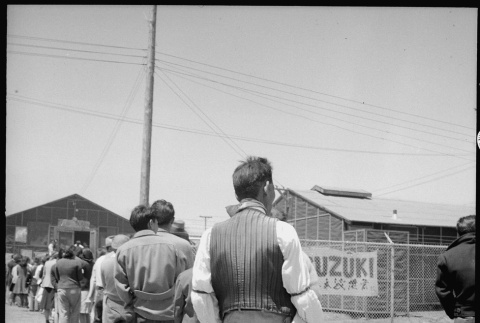 Japanese Americans waiting in mess hall line (ddr-densho-151-347)