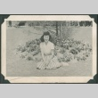 Woman sits by flowers (ddr-densho-321-121)