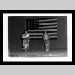 Women in kimono dancing on stage in front of American flag in Tule Lake (ddr-csujad-55-2201)