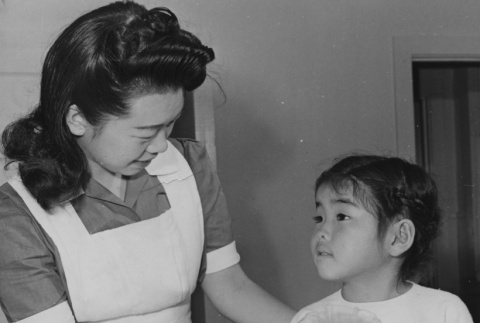 Six-year-old Reiko Mastuda, convalescing from serious illness at Jerome incarceration camp (ddr-csujad-14-16)