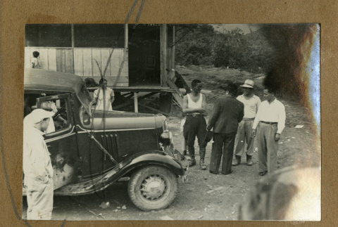 Japanese Peruvian men with a car (ddr-csujad-33-154)
