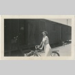 Woman on a bicycle outside barracks (ddr-manz-7-9)