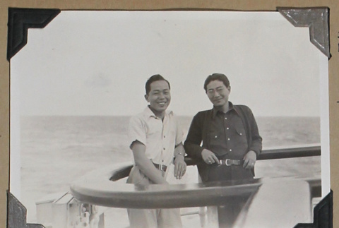 Tokeo Tagami and another man lean against the rail of a ship (ddr-densho-404-264)