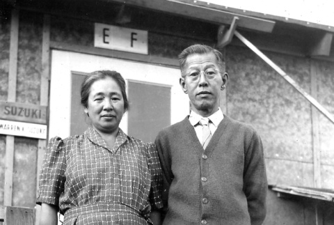 The Suzuki's pose in front of their barracks room at Minidoka concentration camp, Idaho (ddr-densho-243-4)