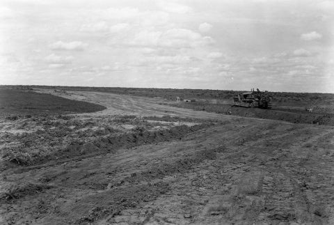 A worker bulldozing an agricultural field (ddr-fom-1-2)