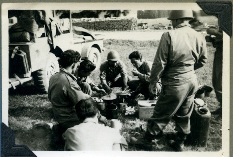 442nd soldiers cooking C rations (ddr-densho-22-31)