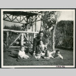 Photograph of Henry Matsumoto with orphan incarcerees at Children's Village (ddr-csujad-47-162)