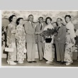 Members of a Japanese dance troupe posing with Honolulu Rotarians (ddr-njpa-2-519)