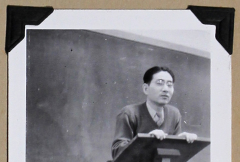 Tokeo Tagami stands at a lectern (ddr-densho-404-377)