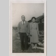 Couple stands outside at camp (ddr-densho-321-49)