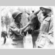 Member of the 522nd Field Artillery Battalion with Italian soldier (ddr-densho-114-93)