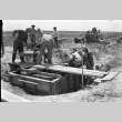 Men working on a wooden structure (ddr-fom-1-7)