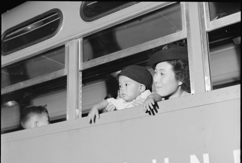 Japanese Americans leaving camp by bus (ddr-densho-37-783)