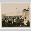 Crowd of people in front of a large building (ddr-densho-223-4)