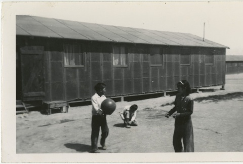 Children playing with a ball in camp (ddr-manz-7-20)