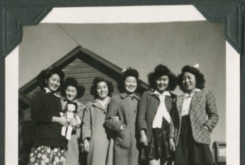 Group of women, one holding a doll (ddr-densho-321-86)