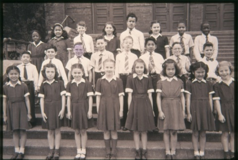 Boys and girls standing on steps outside building (Maryknoll school) (ddr-densho-330-207)