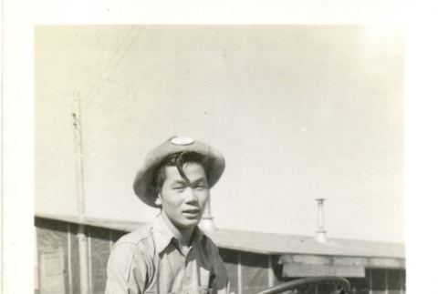 Young man on tractor (ddr-csujad-26-131)