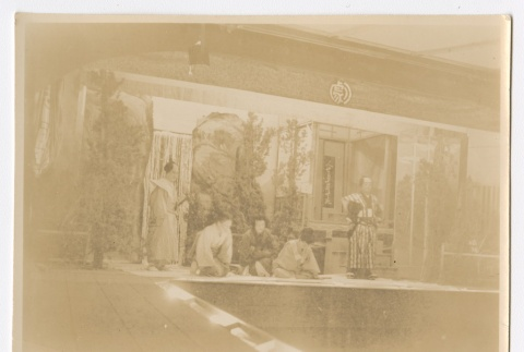 Men and women in traditional Japanese clothing performing in a play (ddr-densho-223-44)