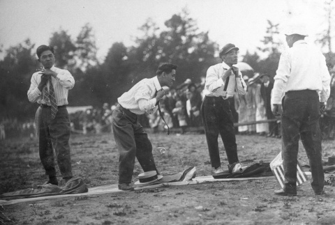Issei men playing a game at a community picnic (ddr-densho-13-7)