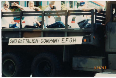 Truck carrying veterans from 2nd Battalion-Company E.F.G.H in parade (ddr-densho-368-418)