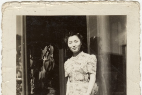 Eiko Kosai standing in front of the Grand Hotel (ddr-densho-349-33)