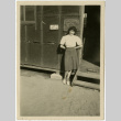 Woman standing in front of barracks (ddr-manz-8-8)