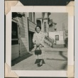 Woman with purse standing outside (ddr-densho-321-236)