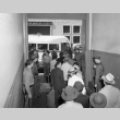 Indonesians boarding buses in San Francisco to be taken to a waiting train (ddr-csujad-27-9)
