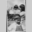 [Adult and children in apple orchard] (ddr-csujad-56-264)