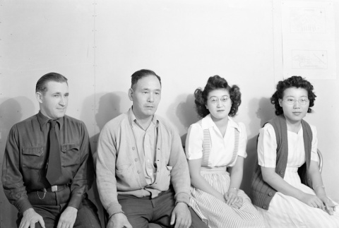 Two women and two men seated on a couch (ddr-fom-1-373)