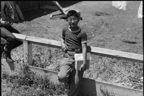 Young boy in assembly center (ddr-densho-151-5)