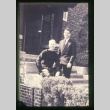 Two men on steps of building (Maryknoll) (ddr-densho-330-13)